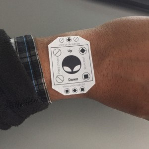 Put the cutout on your wrist as if it's the dial or face of your watch.